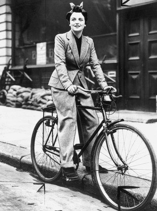 Girl in Trousers rides a bike